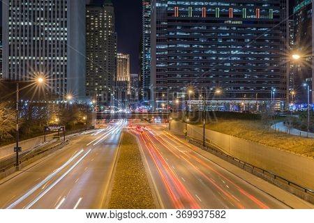 Chicago, Usa - December 16, 2017: Columbus Drive At Night Full Of Car Light Streaks Shot With Long E