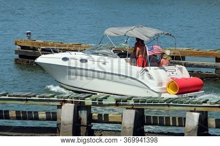 Upscale Motorboat Cruising On The Florida Intra-coastal Waterway Near Miami Beach.