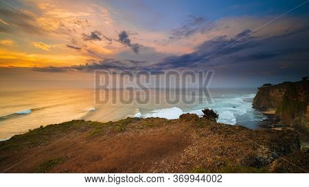 Amazing Seascape. Spectacular View From Uluwatu Cliff In Bali. Sunset Time. Blue Hour. Ocean With Mo