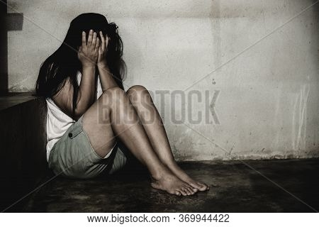 Stressful And Hopeless Woman Sitting On Ground,