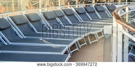 Empty Deck Chairs On The Upper Deck Of A Cruise Ship, Nobody, Outdoor, Sea Recreation Concept