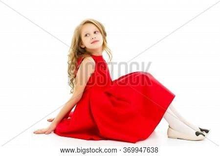 Portrait Of Cute Preteen Girl Sitting On The Floor With Her Knees Up, Adorable Girl With Blond Long