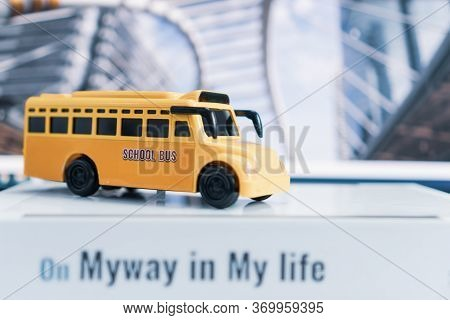 School Bus On Road In Usa For Student Transport Children Transports Service On Stack Books With Word