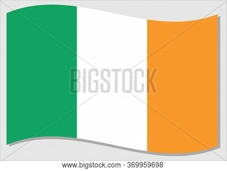 Waving Flag Of Ireland Vector Graphic. Waving Irish Flag Illustration. Ireland Country Flag Wavin In