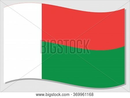 Waving Flag Of Madagascar Vector Graphic. Waving Malagasy Flag Illustration. Madagascar Country Flag