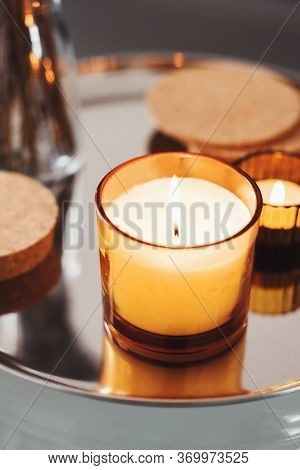 Aroma Candle With Ginger Scent On A Metal Tray. Aromatherapy Concept. Home Decor
