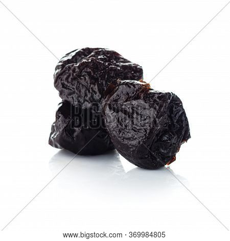 Dried Plum On A White Background, Prune Isolated, Raw Organic Prunes, Smoked Prunes Close-up