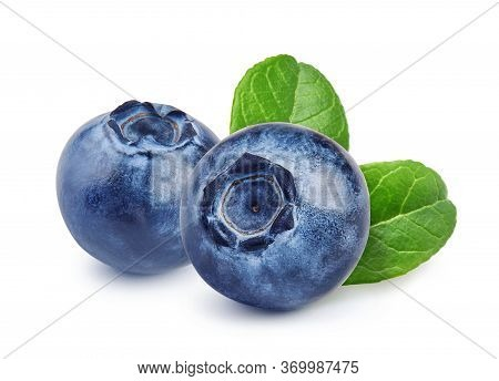 Two Blueberries With Blueberry Leaves Isolated On White. Macro Shutting Of Blueberry.