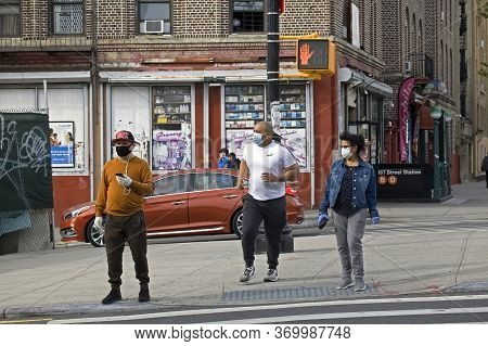 Bronx, New York/usa - May 18, 2020: Latino People Crossing Street Wearing Masks During Covid-19 Pand