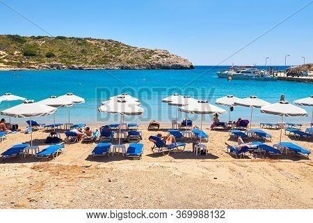 Rhodes, Greece - May 12, 2018: Sandy And Quiet Beach In Kolymbia Village. Rhodes Island. Greece