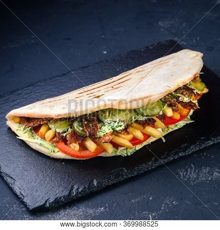 Turkish Fast Food - Lamb In Pita Bread, Crunchy Pita With Grilled Gyros Meat. Various Vegetables And