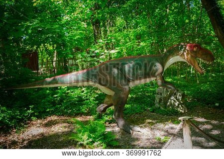 Malbork, Poland - June 1, 2020: Realistic dinosaur at the Dino Park in Malbork, Poland. Dino Park is a tourist attraction with moving dinosaurs and dragons.