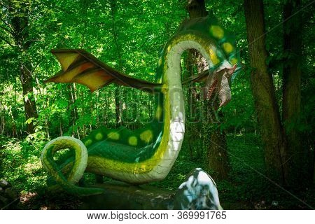 Malbork, Poland - June 1, 2020: Realistic dragon at the Dino Park in Malbork, Poland. Dino Park is a tourist attraction with moving dinosaurs and dragons.