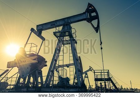 Oil Pump Rig. Oil And Gas Production. Oilfield Site. Pump Jack Are Running. Drilling Derricks For Fo