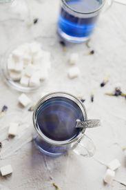 Blue Thai Anchan Tea In A Glass Mug.