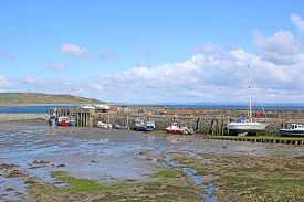 Boats In Drummore Harbour, Scotland, At Low Tide