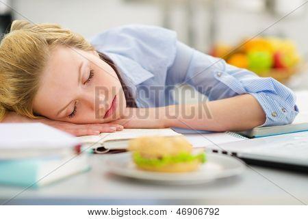 Teenage Girl Fall Asleep While Studying In Kitchen