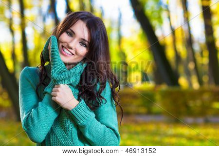 Cute woman wearing a turtleneck sweater in autumn park