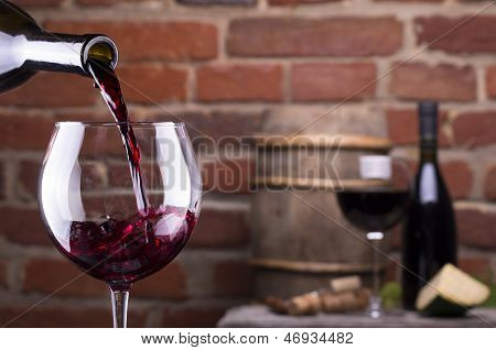 Glass Of Wine Against A Brick Wall