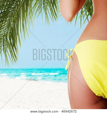 Sexy buttocks of young fit woman with soft and clean skin, in bikini