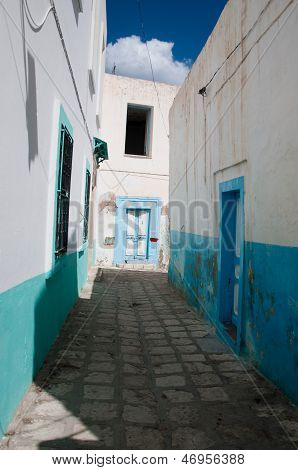 Arabian street with door marked by red paint poster