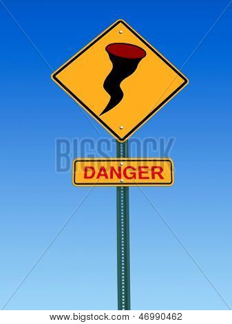 road sign with hurricane icon and danger warning over sky