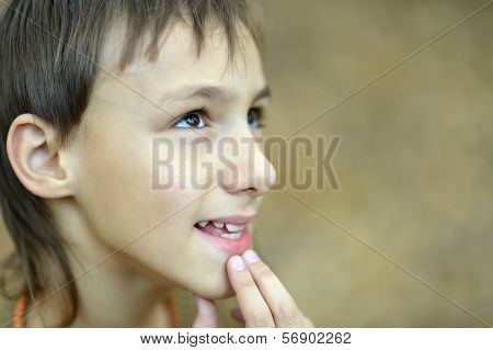 Portrait of thinking young boy