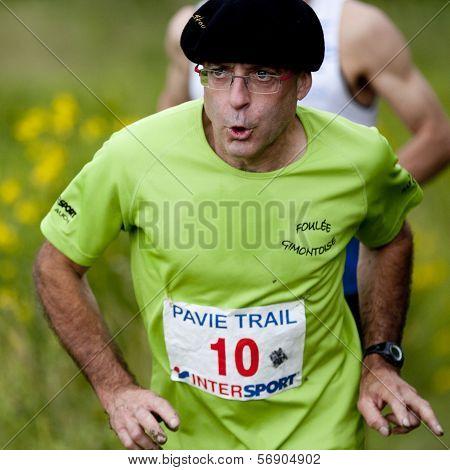 Male runner wearing a beret.