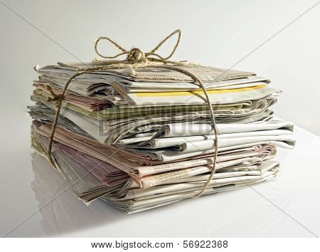 Stack Of Old Newspapers Tied With String
