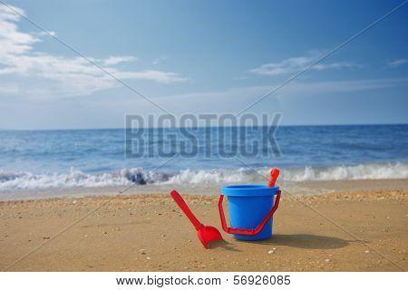 Blue Bucket On Beach