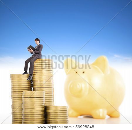Smiling Young Man Counting Coin In Poggy Bank