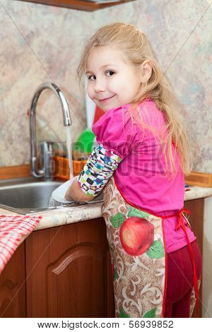 Caucasian Pretty Girl In The Kitchen Washing Dishes