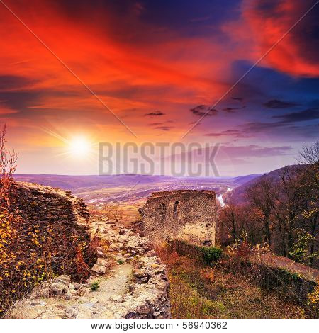 Ruins Of An Old Castle In The Mountains At Sunset