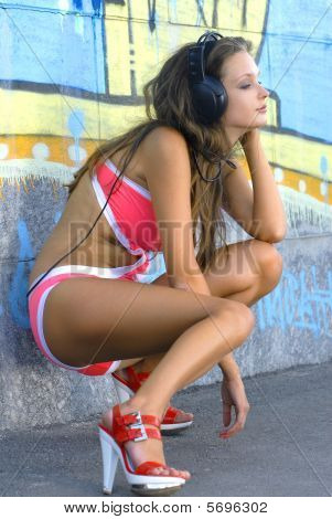 beautiful girl in bathing suit is listening music poster