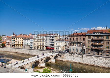 SARAJEVO, BOSNIA AND HERZEGOVINA - AUGUST 11, 2012: Tourists on Latin bridge, the site of the assassination of Archduke Franz Ferdinand by Gavrilo Princip in 1914.