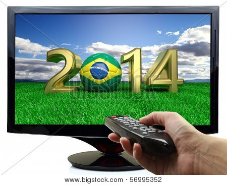 2014 and soccer ball with Brazil flag on tv