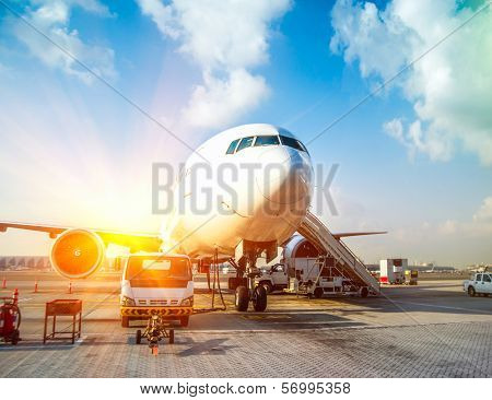 plane and the airport in the setting sun