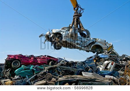 Junkyard Picking Up Car