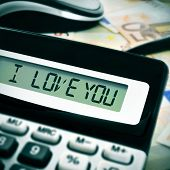 sentence I love you in the display of a calculator poster