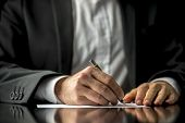 Conceptual image of a man signing a last will and testament document. poster