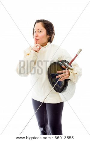 Female fencer with finger on lips