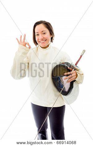 Female fencer showing ok sign