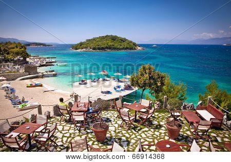 Sunshade umbrellas and deckchairs on the beautiful Ksamil beach, Albania. poster