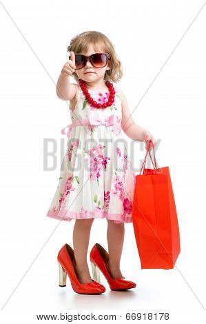 Funny Kid Girl Trying On Her Mom's Red Accessories And Shoes
