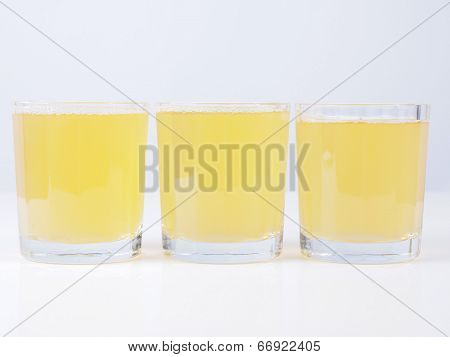 poster of Glasses of pineapple juice on continental breakfast table