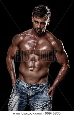 athletic young caucasian man in studio on black background poster