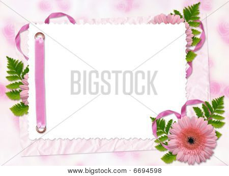 White Frame With Flower And Ribbons On The Pink Background