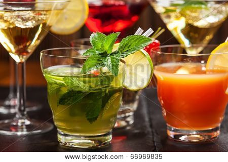 Party cocktails and longdrinks garnished with fruits for summer