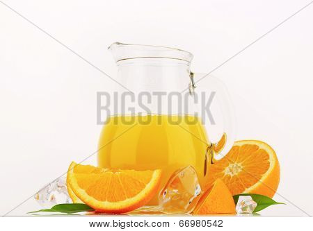 glass pitcher with freshly squeezed orange juice