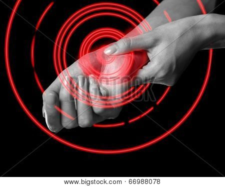 Woman Holds Her Wrist, Carpal Syndrome, Pain Area Of Red Color